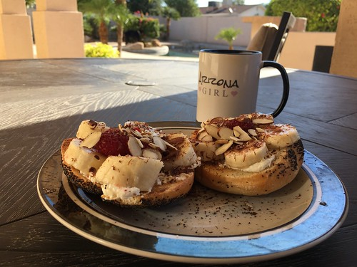 Poppyseed Bagel w/Butter, Whipped Cream Cheese, Banana, Raspberries, Almonds and Dark Orange Chocolate Shavings + Coffee.