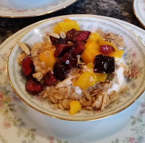 Coconut Cardamom Granola on Greek Yogurt with Fresh Cherries & Mango