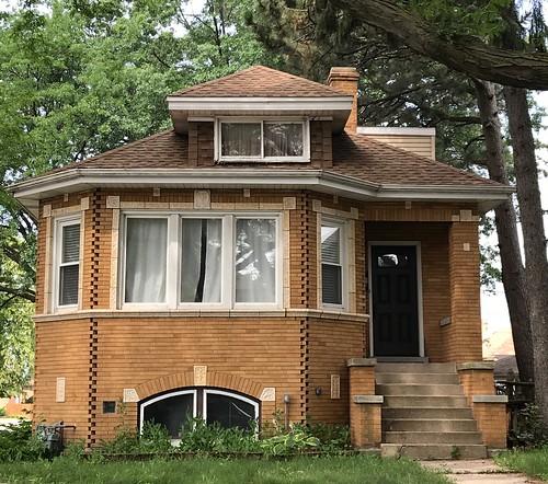 Brick bungalow with terra cotta trim