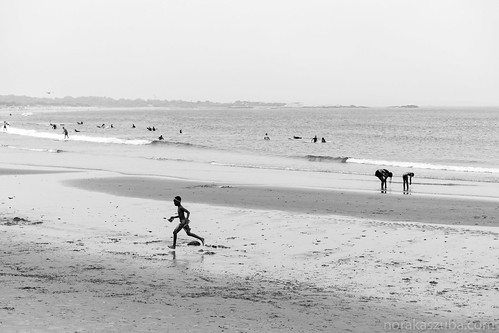 Running on the beach during a foggy summer day.