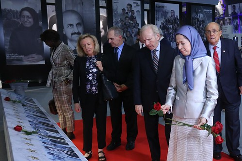 Laying flowers on the photos of martyrs of the massacre in Ashraf on September 1, 2013- July 12, 2019