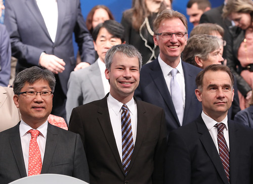 Young Tae Kim, Steffen Bilger, and Yevgen Koziy ready for the family photo