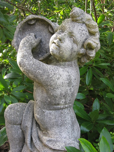 Detail of a Stone Cherub Playing the Tamborine - the Forest Glade Gardens; Mount Macedon Road, Mount Macedon