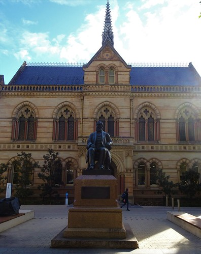 Adelaide. The Mitchell building built 1881 at the University of Adelaide. In front is the statue of Sir Walter Watson Hughes of Moonta Mines who donated 20,000 pounds to start the university in 1872.