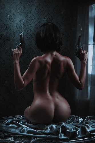 Beautiful fit naked armed woman