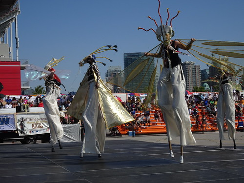 Moko Jumbies on stage at Grand Parade