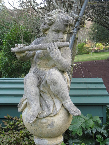 A Stone Cherub Playing the Flute - the Forest Glade Gardens; Mount Macedon Road, Mount Macedon