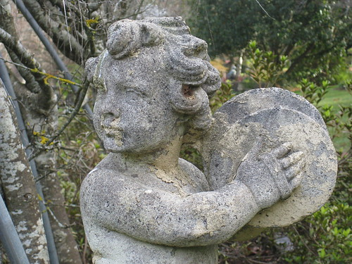 Detail of a Stone Cherub Playing the Drum - the Forest Glade Gardens; Mount Macedon Road, Mount Macedon