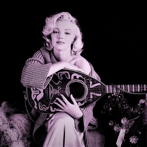 Milton Greene- Marilyn Monroe with mandolin. Los Angeles, California, 1953. d  2