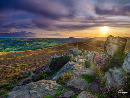 Heather and sunset over the Hope Valley from Win Hill in the Peak District National Park