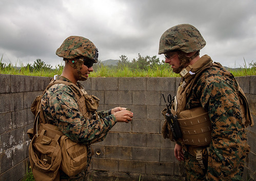 U.S. Marines conduct M67 fragmentation hand grenade training on Camp Hansen