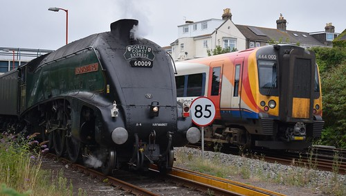 Dorset Coast Express 60009 Union of South Africa waits to enter Weymouth station from Jubilee Sidings as 444002 departs for London Waterloo