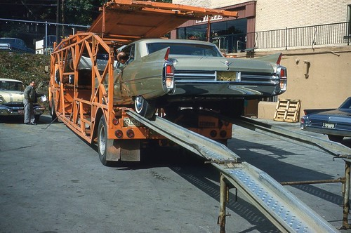 New 1963 Cadillacs being unloaded at Barrett Cadillac, Youngstown OH