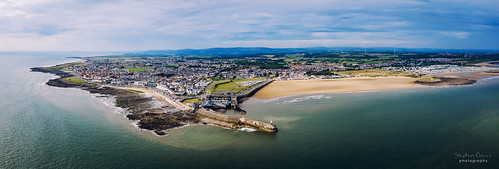 Aerial view of Porthcawl beach harbour and fun fair in South Wales UK