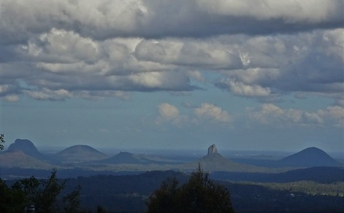 Maleny in the hinterlands of the Sunshine Coast Queensland. A wonderful view of the volcanic landscape of the Glasshouse Mountains from Mary Cairncross Park near Maleny. Named by Captain James Cook in 1770.