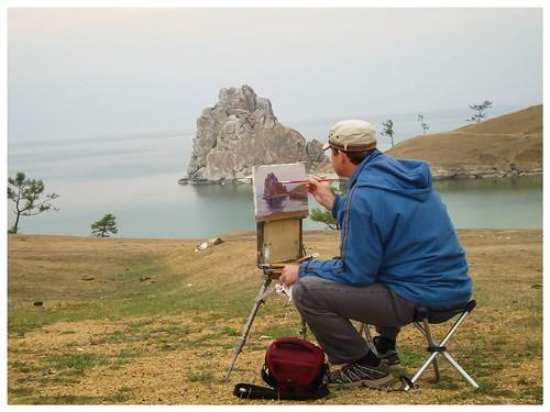 The Irkutsk based painter Sergey Kanzantsev is painting Shamanka Rock (on Olkhon  Island, Seberia)