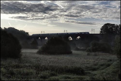 Earlestown, Sankey Viaduct, TPE 68027 1E25 (06.56 Liverpool Lime Street - Scarborough) 24/08/19.