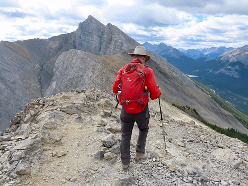 Grassi Lakes to Ha Ling Peak summit hike - Larry starts the descent, with Spray Lakes peaking at us from a distance