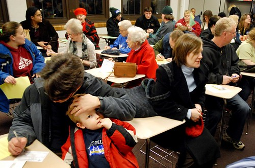 4-year-old Isaac Lynx waits as his father Daniel Lynx Bernard fills out his caucus paperwork at the Ward 4 Precinct 5 room for the DFL caucus at Ramsey Junior High School in St. Paul, Minn., on Tuesday, February 5, 2008.