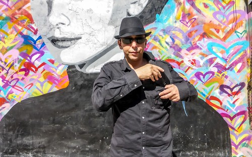 Ash stands near a colorful mural in downtown Los Angeles (#2)