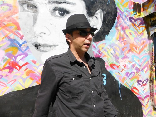 Ash stands near a colorful mural in downtown Los Angeles (#1)