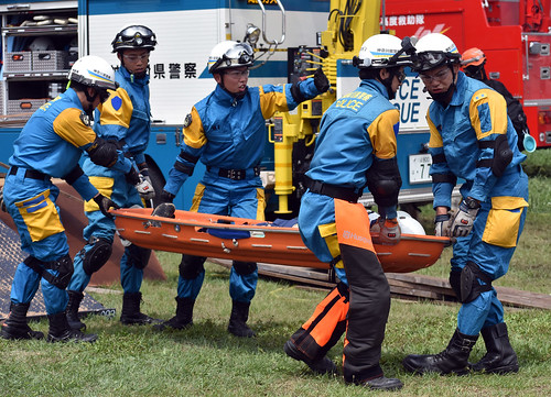 Members of the Kanagawa Prefecture Police Department rescue crew remove a simulated casualty