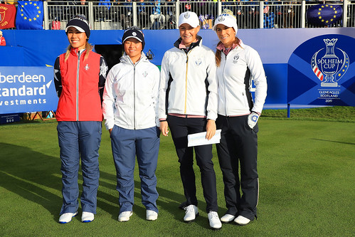 Danielle Kang of the USA, Megan Khang of the USA, Charley Hull of England and Azahara Munoz of Spain pose on the first thee during Saturday morning foursomes