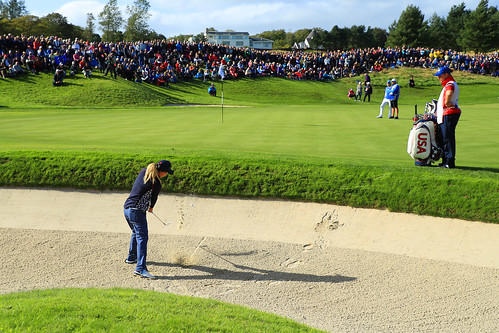 Danielle Kang of the USA takes her second shot on the 17th hole during Sunday single matches