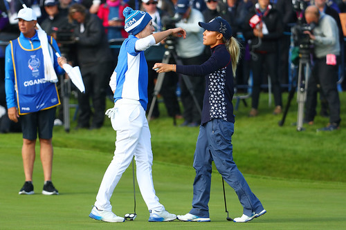 Carlota Ciganda of Spain (L) and Danielle Kang of the USA embrace as Ciganda wins her match during Sunday single matches