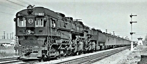SP, BLW. Train No. 60 hauled by an early Baldwin built Mallet No. 4118 of cab foremost design. Engine is of 4-8-8-2 type at speed of about 40 mph. ca1940s