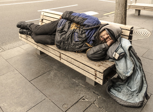 The homeless man with his sleeping bag on Queen Street, Auckland CBD, New Zealand.