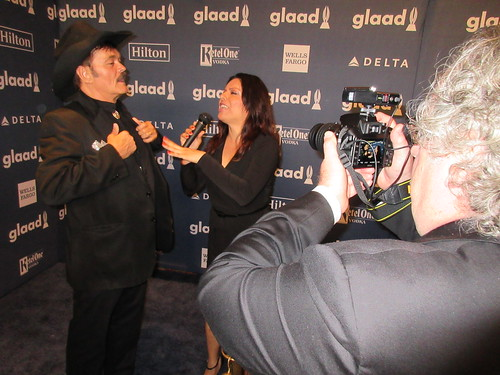 Kendall Kay, Randy Jones the original cowboy from the Village People, Samara Riviera on the red carpet at the press step and repeat wallpaper for the GLAAD Media Awards at the Waldorf Astoria Hotel in New York City