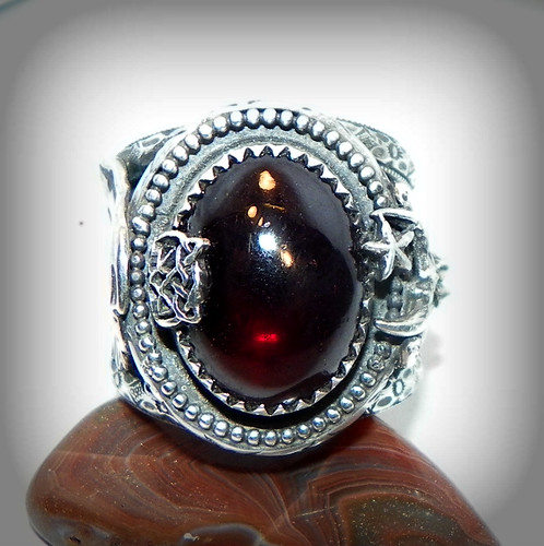 Morrigan Favor Midwinter Yule Festival Red Garnet set in a handcrafted Sterling Crow moon and Goddess Ring.