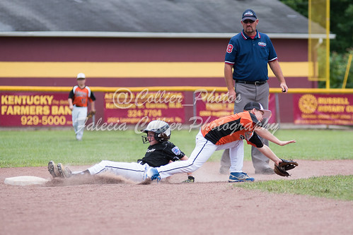 Sadie Price slides in safely for Fleming as Tanner Johnson comes off the bag to stop the throw