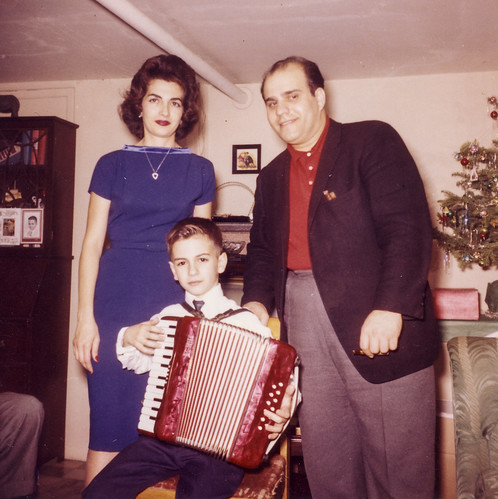 A Bronx Christmas, the accordionist, 1962 (Explore)