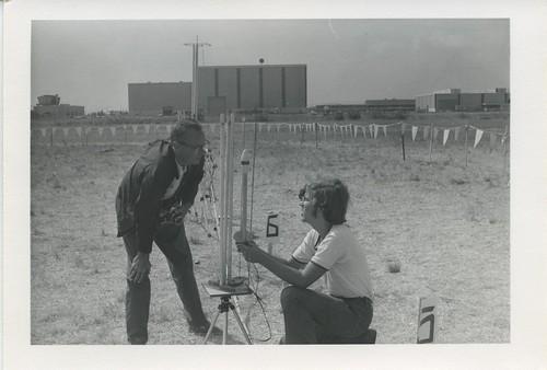 [Two men discuss a model rocket]