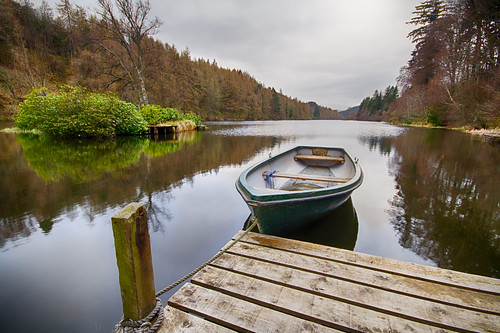 Loch Park looks quiet and peaceful on a chill April day. Fine art colour. Drummuir, Near Dufftown, Moray, Scotland