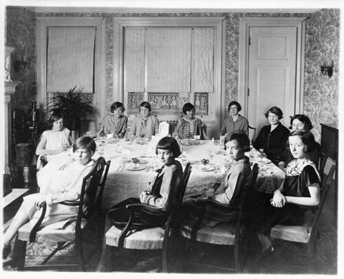 [Eleven girls seated around dining room table, probably a birthday party held in Washington, D.C.] (LOC)