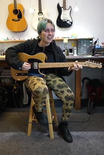 Harmony Tividad listening closely like she's never heard it before.....an amazing difference, neelyguitars.com