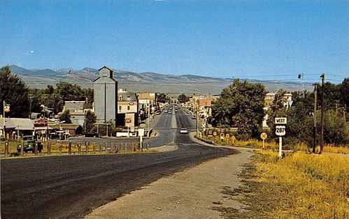 Lander Wyoming~US Highway 287 Sign~Grain Elevator~Phillips 66~RR Crossing~1950s