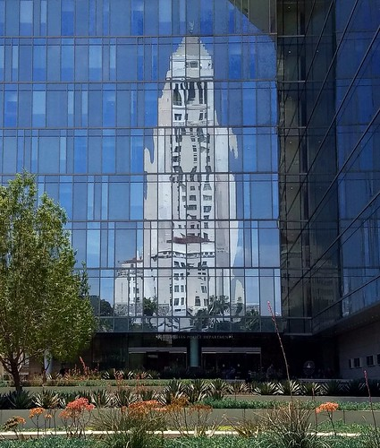 Los Angeles City Hall reflection on downtown L.A.P.D. headquarters' windows.  Los Angeles, California USA 4.18.2018