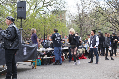 People in Tompkins Square Park while Headsplitters tear down and Olor A Muerte set up.