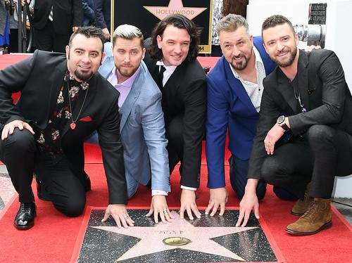 'N Sync got emotional while reuniting for their Hollywood Walk of Fame star
