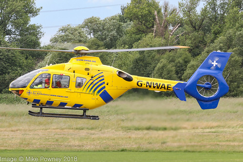 G-NWAE - 2003 build Eurocopter EC135 T2, departing Barton on a patient transfer mission