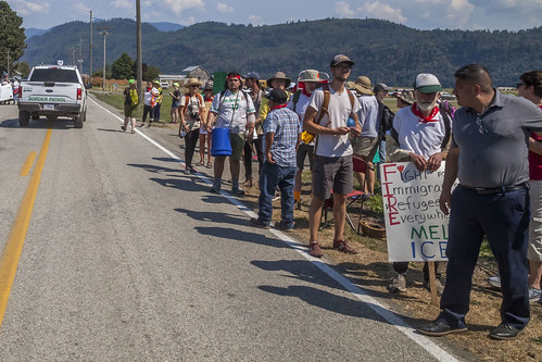 Farm workers march to protest the death of a H-2A farm worker
